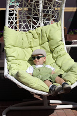 Child resting in the sun lounger
