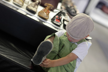 Child trying on shoes