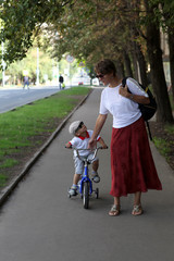 Mother with her son walking in the park