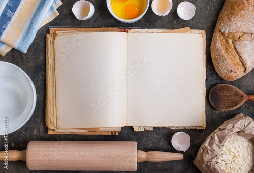 Baking background with blank cook book, flour, rolling pin - 77487939