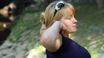 Woman stretches her arms.