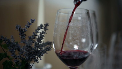 pouring wine in to special glass
