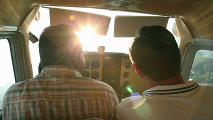 Airplane in air with pilot and copilot