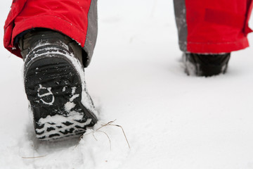 trekking boots in the snow close up
