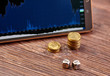 Coins, tablet, dices cubes, financial chart