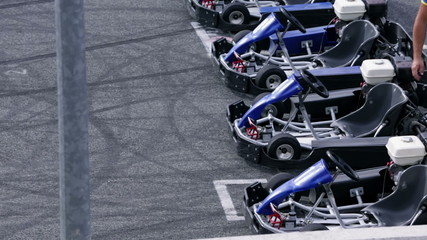 Four empty go-karts on the racing track