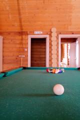 White billiard ball on a green billiard table