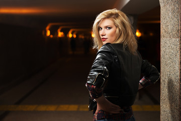 Young fashion blond woman in leather jacket