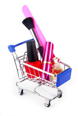 close up of makeup accessories in shopping trolley