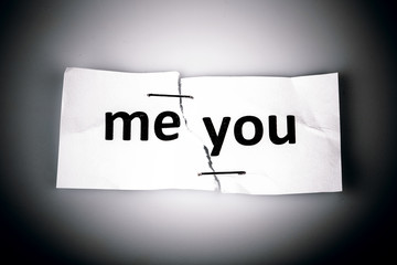 """ME YOU"" words written on torn and stapled paper - love concept"