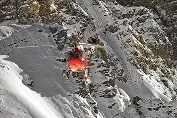 Red helicopter at swiss alps