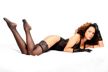Sensual brunette with black body lingerie and stockings
