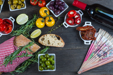 Authentic spanish tapas selection on wooden table from above