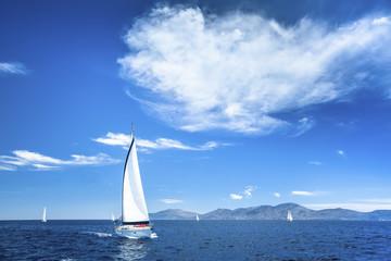 Boat in sailing regata on the Sea.