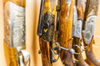 close up of a row of guns displayed in gun shop - 77496172
