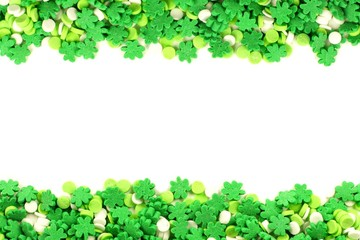 St Patricks Day frame of green shamrock candy sprinkles