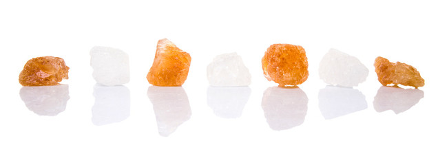 White rock sugar and sugar cane rock over white background