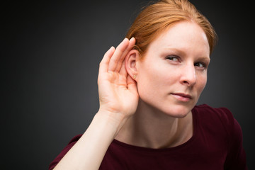 Curious Woman Listens to Rumors
