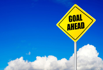 Goal ahead message on road sign