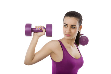 Beautiful girl with dumbbells isolated.