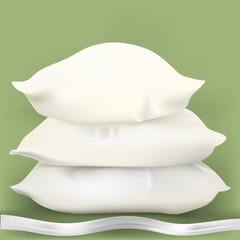 Three white pillows with ribbon