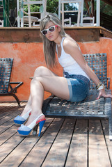 Fashion lady on with sunglasses and short jean