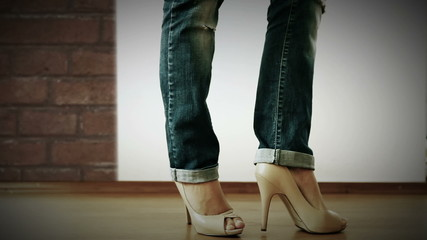 High heels shoes with ripped jeans Fashion Show