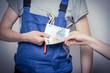 Leinwanddruck Bild - Bauarbeiter mit Geld