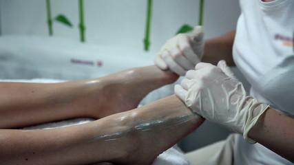 Feet massage in a beauty salon
