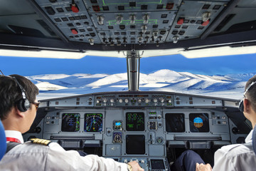 Pilots in the plane cockpit