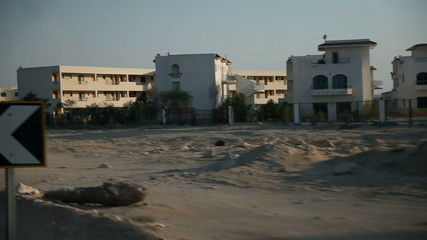 Traveling on road through deserted place with tourist apartments