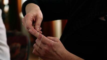 Close shot of a hands knitting