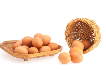 Eggs are stacked in bamboo tray and wicker baskets .