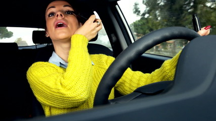 Cute lady putting makeup while driving car