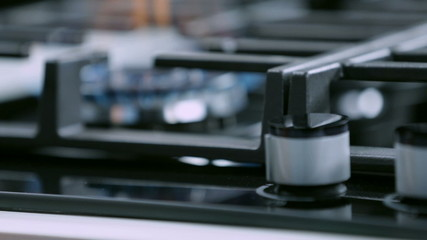 Turning on the cooktop with pushing the button