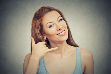 woman making showing call me gesture sign with hand