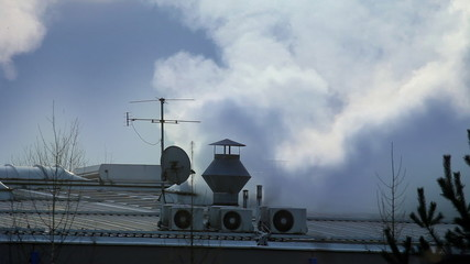 Moving clouds above factory