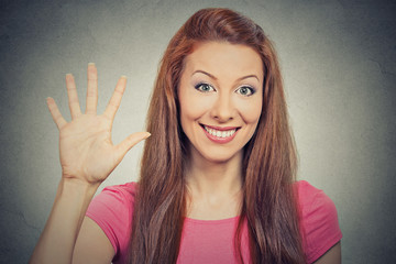 woman showing five times sign hand gesture on grey background