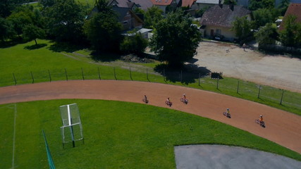 Tracking children competing in bicycle race