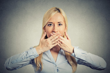 woman covering closed mouth hands grey background