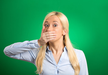 Shocked woman forced to cover her mouth with hand