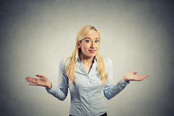 Confused clueless woman arms out shrugs shoulders