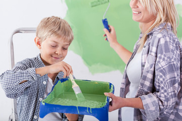Boy holding paint tray