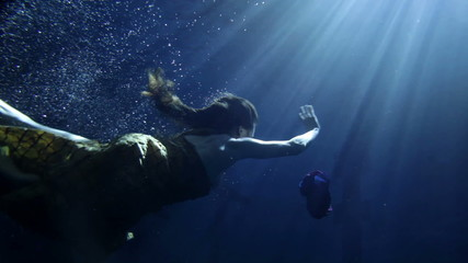 underwater activity and woman swimming under water in clothes