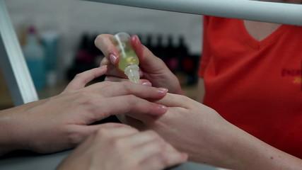 Repairing nails in beauty salon