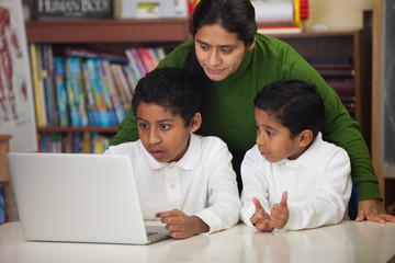 Hispanic Family with Laptop in Homeschool Setting