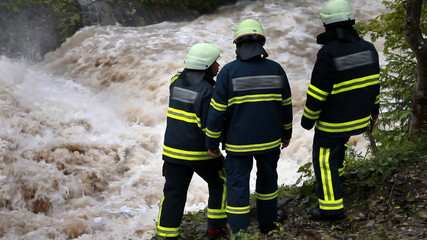 Firemen watching water