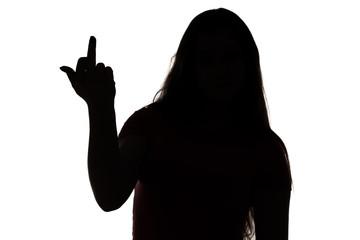Silhouette of angry teenage girl