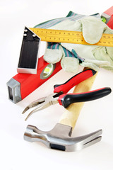 Many small working tools over white background