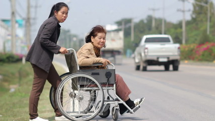 senior woman using a wheelchair cross street (sound quality)